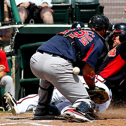 March 16, 2011; Lake Buena Vista, FL, USA; Atlanta Braves second baseman Brooks Conrad (7) slides past Boston Red Sox catcher Jarrod Saltalamacchia (39) for a run during a spring training exhibition game at the Disney Wide World of Sports complex. Mandatory Credit: Derick E. Hingle
