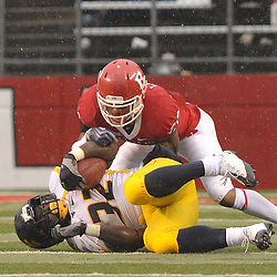 Dec 5, 2009; Piscataway, NJ, USA; Rutgers cornerback Joe Lefeged (26) tackles West Virginia running back Ryan Clarke (32) during second half NCAA Big East college football action in West Virginia's 24-21 victory over Rutgers at Rutgers Stadium.
