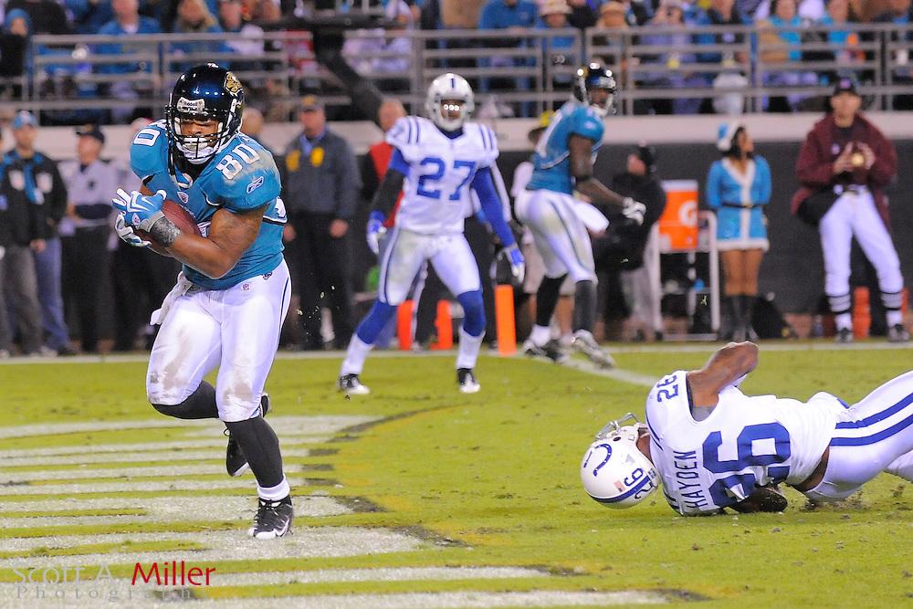 Dec. 17, 2009; Jacksonville, FL, USA; Jacksonville Jaguars wide receiver Mike Thomas (80) scores a third quarter touchdown in the Jags game against the Indianapolis Colts at Jacksonville Municipal Stadium. ©2009 Scott A. Miller.© 2009 Scott A. Miller