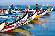 Traditional brightly painted gondola style moliceiro canal boats in Aveiro, Portugal
