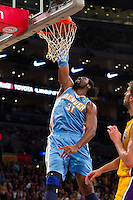 31 December 2011: Forward Nene of the Denver Nuggets dunks the ball against the Los Angeles Lakers during the first half of the Lakers 92-89 victory over the Nuggets at the STAPLES Center in Los Angeles, CA.