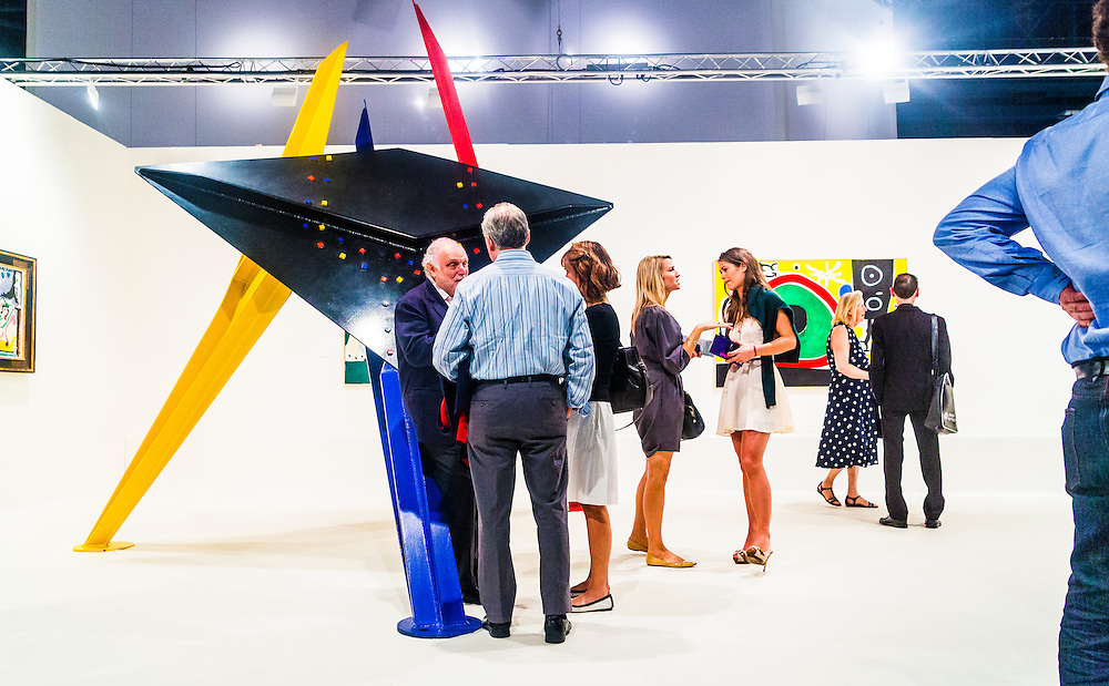 """Art Basel Miami Beach 2012 -- Sculpture is """"Tableau Noir"""" by Alexander Calder; painting at right is by Joan Miró"""