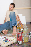 Artist With Painting Tools on Floor of Studio