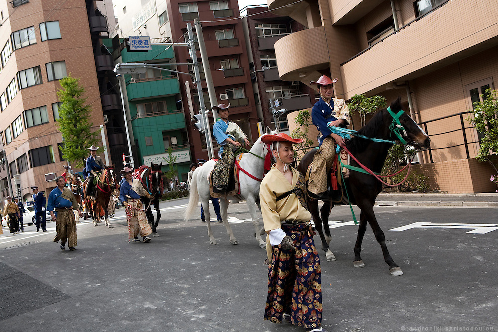 After the end of Yabusame ritual in Asakusa, the archers are returning the horses to their stables.