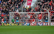 Bristol City forward Lee Tomlin (9) opens the scoring to make it 1-0 during the Sky Bet Championship match between Bristol City and Sheffield Wednesday at Ashton Gate, Bristol, England on 9 April 2016. Photo by Adam Rivers.