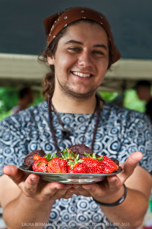 Illyan with a plate of  ChocoSol chocolate and large red Cabot strawberries