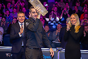 The 2019 19.com World Snooker Scottish Open Champion Mark Selby holds aloft the Stephen Hendry Trophy after being presented by Katie Oldfield Event director of World Snooker & Jason Ferguson WPBSA Chairman at the 19.com  World Snooker Scottish Open Final Mark Selby vs Jack Lisowski at the Emirates Arena, Glasgow, Scotland on 15 December 2019.