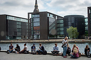 Event Photography images taken during the 2018 Podcast Day, held at The Black Diamond (Den Sorte Diamant) in Copenhagen, Denmark.<br /> <br /> Attendees relax by the water.  <br /> <br /> © Event Photographer in Copenhagen Matthew James
