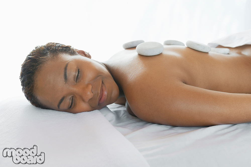 Woman Receiving LaStone Therapy Treatment