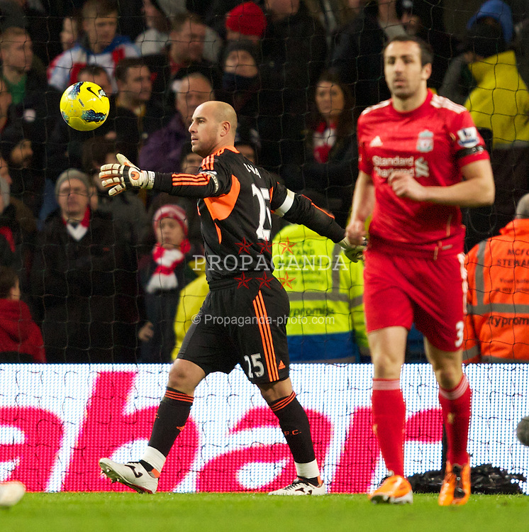 MANCHESTER, ENGLAND - Tuesday, January 3, 2012: Liverpool's captain and goalkeeper Jose Reina looks dejected after making a mistake to hand Manchester City the opening goal during the Premiership match at the City of Manchester Stadium. (Pic by Vegard Grott/Propaganda)
