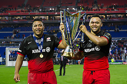 Brothers Mako and Billy Vunipola celebrate with the European Rugby Champions Cup trophy - Mandatory byline: Patrick Khachfe/JMP - 07966 386802 - 14/05/2016 - RUGBY UNION - Grand Stade de Lyon - Lyon, France - Saracens v Racing 92 - European Rugby Champions Cup Final.