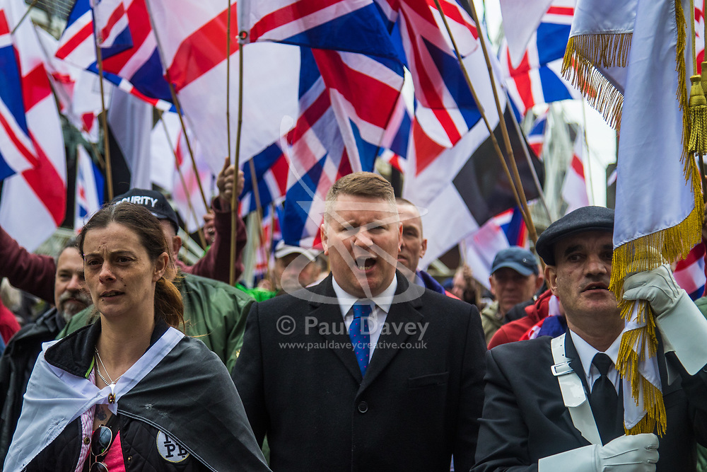 London, April 1st 2017. Britain First Leader Paul Golding marches with his 150-strong crowd as protesters from his nationalist and anti-Islamic group demonstrate in London following the Westminster terror attack of March 22nd.