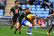 Wasps flyhalf Jimmy Gopperth (12) tackles Bath centre Max Wright (13) during the Gallagher Premiership Rugby match between Wasps and Bath Rugby at the Ricoh Arena, Coventry, England on 2 November 2019.
