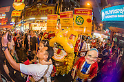 "09 FEBRUARY 2013 - BANGKOK, THAILAND: Lion Dancers and people mingle on Yaowarat Road in Chinatown in Bangkok. Bangkok has a large Chinese emigrant population, most of whom settled in Thailand in the 18th and 19th centuries. Chinese, or Lunar, New Year is celebrated with fireworks and parades in Chinese communities throughout Thailand. The coming year will be the ""Year of the Snake"" in the Chinese zodiac.    PHOTO BY JACK KURTZ"