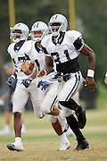 OXNARD, CA - AUGUST 17:  Wide receivers Sam Hurd #17, Miles Austin #14, and Terrell Owens #81 of the Dallas Cowboys work out during Dallas Cowboys training camp on August 17, 2006 in Oxnard, California. ©Paul Anthony Spinelli *** Local Caption *** Sam Hurd;Miles Austin;Terrell Owens