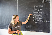 VSO ICS volunteer Jamie Steers writing on the blackboard at the beginning of the class about writing a CV and applying for work with students at Mingoyo school. Part of the VSO / ICS Elimu Fursa project (Opportunities in Education) Lindi, Lindi region. Tanzania.