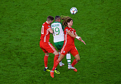 CARDIFF, WALES - Thursday, September 6, 2018: Wales' Ethan Ampadu (right) and Chris Mepham (left) with Republic of Ireland's Jonathan Walters during the UEFA Nations League Group Stage League B Group 4 match between Wales and Republic of Ireland at the Cardiff City Stadium. (Pic by Laura Malkin/Propaganda)