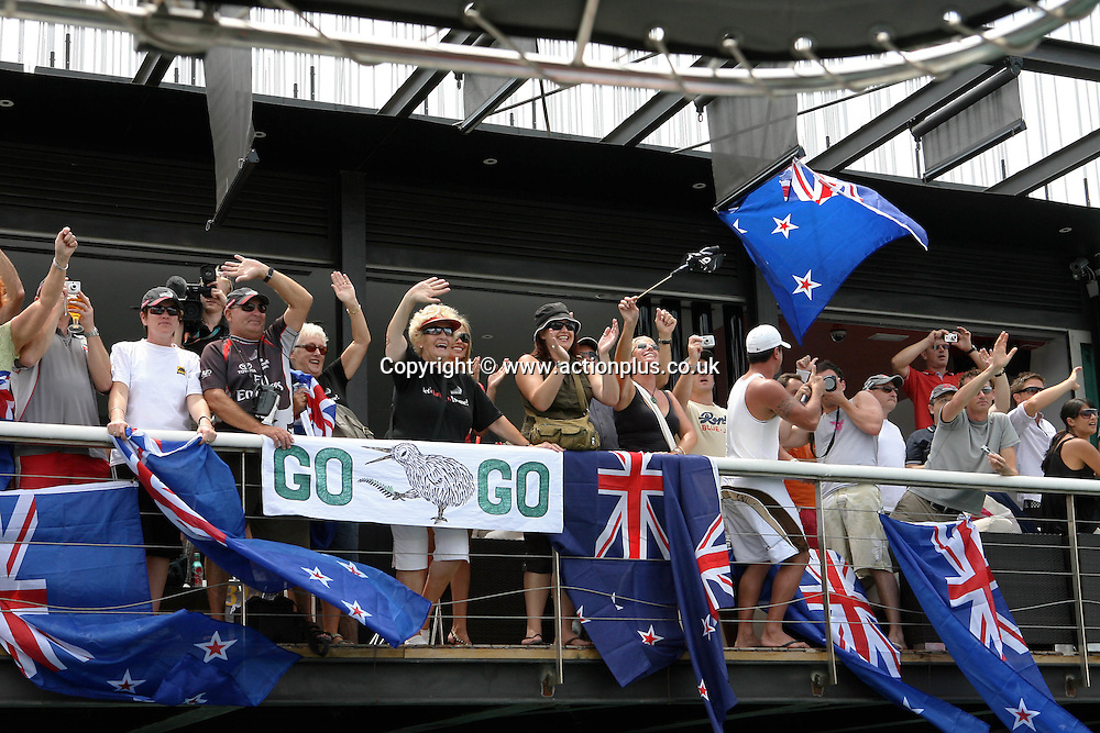 23 June 2007: New Zealand supporters on the dockside before the first race between Emirates Team New Zealand and Alinghi in the America's Cup. Race one, was won by the Swiss Alinghi team. Photo: Ingrid Abery/action plus<br /> <br /> <br /> sailing yachting yacht boat racing 070623 fan