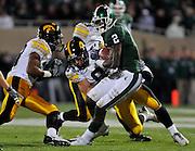 Oct 24, 2009; East Lansing, MI, USA; Iowa cornerback Tyler Sash (9) tackles Michigan State wide receiver Mark Dell (2) during the first quarter at Spartan Stadium.  Mandatory Credit: Jason Miller-US PRESSWIRE