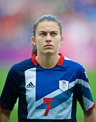 COVENTRY, ENGLAND - Friday, August 3, 2012: Great Britain's Karen Carney lines-up for the national anthems during the Women's Football Quarter-Final match between Great Britain and Canada, on Day 7 of the London 2012 Olympic Games at the Rioch Arena. Canada won 2-0. (Photo by David Rawcliffe/Propaganda)