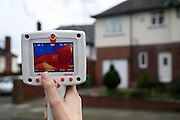 A hand held thermographic camera used to test the efficiency of insulation in a house.