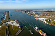 Nederland, Zuid-Holland, Rotterdam, 18-02-2015; Maeslantkering in de Nieuwe Waterweg, gezien naar de Noordzee en Tweede Maasvlakte (MV2). Links het Calandkanaal en de Maasvlakte, rechts aan de horizon Hoek van Holland. De stormvloedkering bestaat uit twee deuren die klaar liggen in een dok en welke sluiten bij een waterstand van 3 meter of meer boven NAP. De kering, laatst voltooide onderdeel van Deltawerken, beschermt Rotterdam en achterland bij extreme waterstanden.<br /> The new storm surge barrier (Maeslantkering) in the Nieuwe Waterweg (New Waterway, the entrance to the port of Rotterdam), North Sea at the horizon. In case of storm floods, the two enormous doors will close of the waterway protecting Rotterdam and its hinterland<br /> luchtfoto (toeslag op standard tarieven);<br /> aerial photo (additional fee required);<br /> copyright foto/photo Siebe Swart