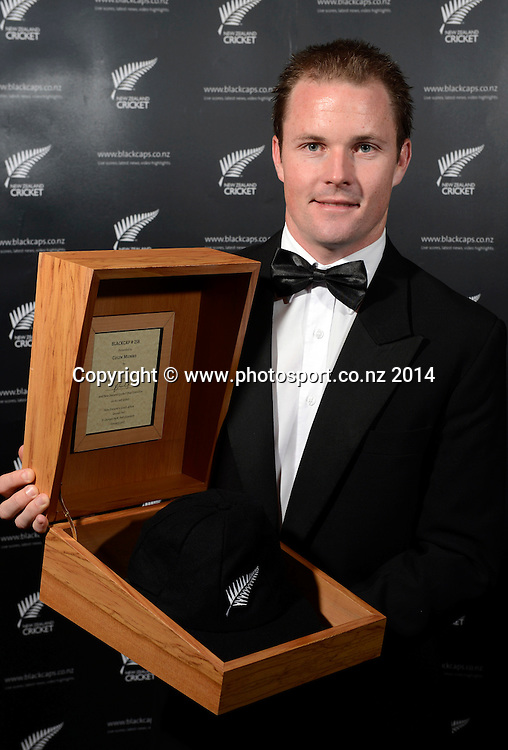 Colin Munro poses for a picture with his Test Cap at the 2013/14 New Zealand Cricket Annual Awards dinner at the Langham Hotel in Auckland, New Zealand. Photo: Andrew Cornaga/www.Photosport.co.nz