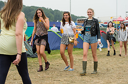 © Licensed to London News Pictures. 05/09/2014. Isle of Wight, UK. Festival goers walking through the campsite at Bestival 2014 Day 2 Friday.  This weekend's headliners include Chic featuring Nile Rodgers, Foals and Outcast Photo credit : Richard Isaac/LNP