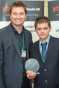 George Clarke with the 14 - 16 year old winner Jake George.  Young Builder of the Year Awards 2013, House of Commons, Westminster, London.