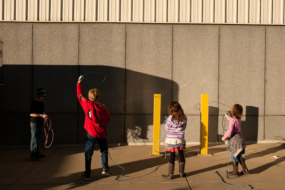 Children work on their roping skills outside of the Denver Events Center, one of the buildings that hosts events for the stock show.