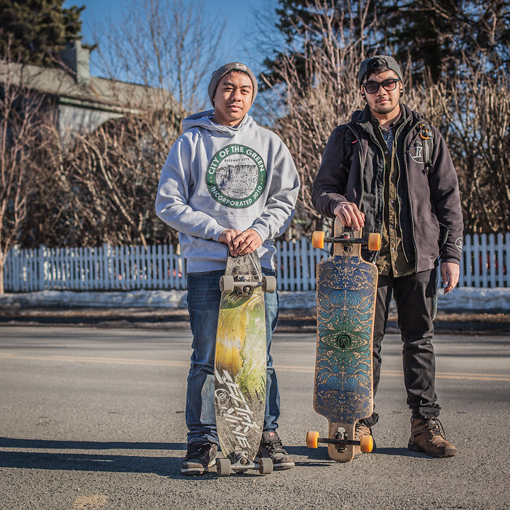 Dimond High seniors and long-boarders David Tinilla and Justin Camillo on Tenth Avenue near G Street, Anchorage.                   &quot;Like most Alaskans I fish, camp, and hunt in the summer time but I'm also quite fond of my city...I often hear my peers claiming there's nothing to do here, or that we lack culture.  As an Anchorage youth I believe it's our responsibility to work with our given circumstances to make the best of it.  Anchorage started as a tent city, a city of canvases you might say.  I think we should paint our picture and leave an imprint.  With longboarding, it's not so much the transportation that makes it great, it's the freedom.&quot;<br />       <br /> ir1_93@hotmail.com