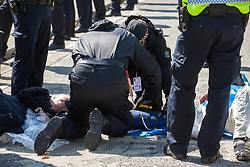London, UK. 4 September, 2019. A Metropolitan Police cutting team takes steps to remove anti-nuclear activists who had succeeded in locking themselves together using an arm tube to block one of the two main access roads to ExCel London during protests on the third day of a week-long carnival of resistance against DSEI, the world's largest arms fair. The third day's protests were organised by the Campaign for Nuclear Disarmament (CND) and Trident Ploughshares.