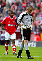 Photo. Chris Ratcliffe<br />Charlton v Fulham. FA Premiership. 11/05/2003<br />Dean Kiely troops off in disbelief with Kevn Lisbie looking on after being sent off for his challenge on Louis Saha