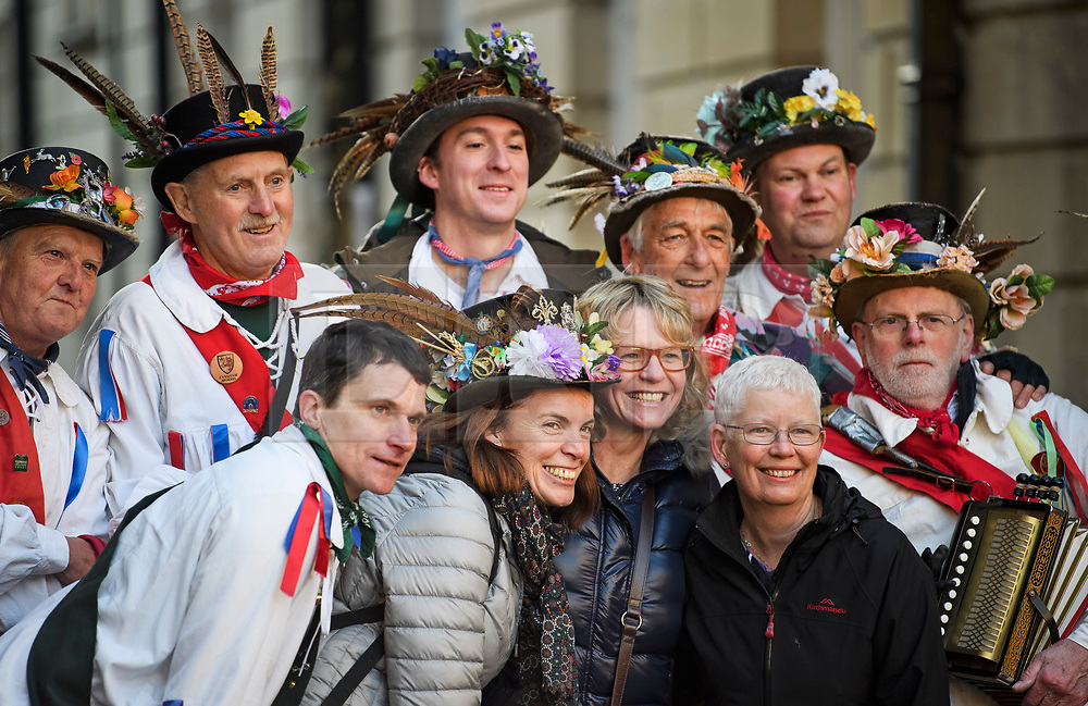 "© Licensed to London News Pictures. 01/05/2018. Oxford, UK. Morris dancers in dress pose for a photograph with tourists as they prepare to dance next to Hertford Bridge, often called ""the Bridge of Sighs"" in Oxford, Oxfordshire as part of May Day celebrations. Students were again prevented from jumping from Magdalen Bridge in to the river, which has historically been a tradition, due to injuries at a previous years event . Photo credit: Ben Cawthra/LNP"