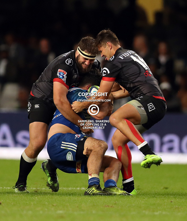 DURBAN, SOUTH AFRICA - MAY 27: Thomas du Toit of the Cell C Sharks and Kobus van Wyk of the Cell C Sharks tackle Dillyn Leyds of the DHL Stormers during the Super Rugby match between Cell C Sharks and DHL Stormers at Growthpoint Kings Park on May 27, 2017 in Durban, South Africa. (Photo by Steve Haag/Gallo Images)