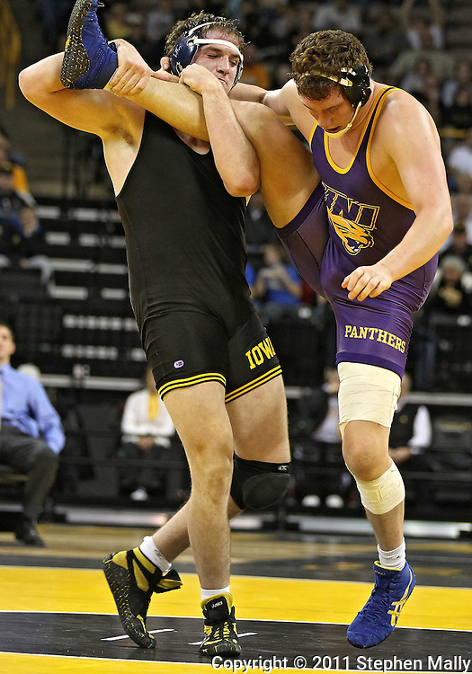 December 8, 2011: Iowa Hawkeyes Bobby Telford grabs the leg of Northern Iowa Panthers Blayne Beale in the heavyweight pound bout of the NCAA wrestling dual between the Northern Iowa Panthers and the Iowa Hawkeyes at Carver-Hawkeye Arena in Iowa CIty, Iowa on Thursday, December 8, 2011. Telford defeated Beale 12-0 and Iowa defeated Northern Iowa 38-4.