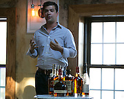 "Kyle Gilligan of Beam Suntory explains the history of Kentucky Bourbon at the ""All Things Beam"" seminar and tasting at The Daily Refresher, part of the Rochester Cocktail Revival in Rochester on Thursday, May 7, 2015."