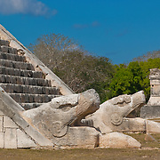 Detail of snake heads at El Castillo temple in Chichen Itza. Yucatan, Mexico.