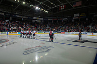 KELOWNA, BC - DECEMBER 27:  The Kelowna Rockets line up on the blue line for the national anthem at the start of the game against the Kamloops Blazers at Prospera Place on December 27, 2019 in Kelowna, Canada. (Photo by Marissa Baecker/Shoot the Breeze)