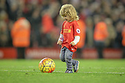 Joe Allen's son Archie kicks the ball towards the Kop after the Barclays Premier League match between Liverpool and Chelsea at Anfield, Liverpool, England on 11 May 2016. Photo by Mark P Doherty.