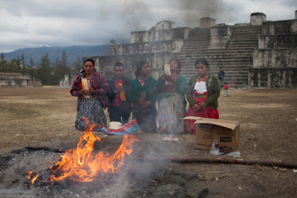 A small group of people independently carry their own spiritual ceremony in the ancient Mayan site of Zaculeu marking the end of the Mayan Era known as 13 Baktun. Zaculeu, Huehuetenango, Guatemala. December 21, 2012.