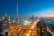 Downtown Dubai with Burj Khalifa and Sheikh Zayed Road .Blue hour, twilight city skyline at sunset with illuminated skyscrapers and car lihght trails.