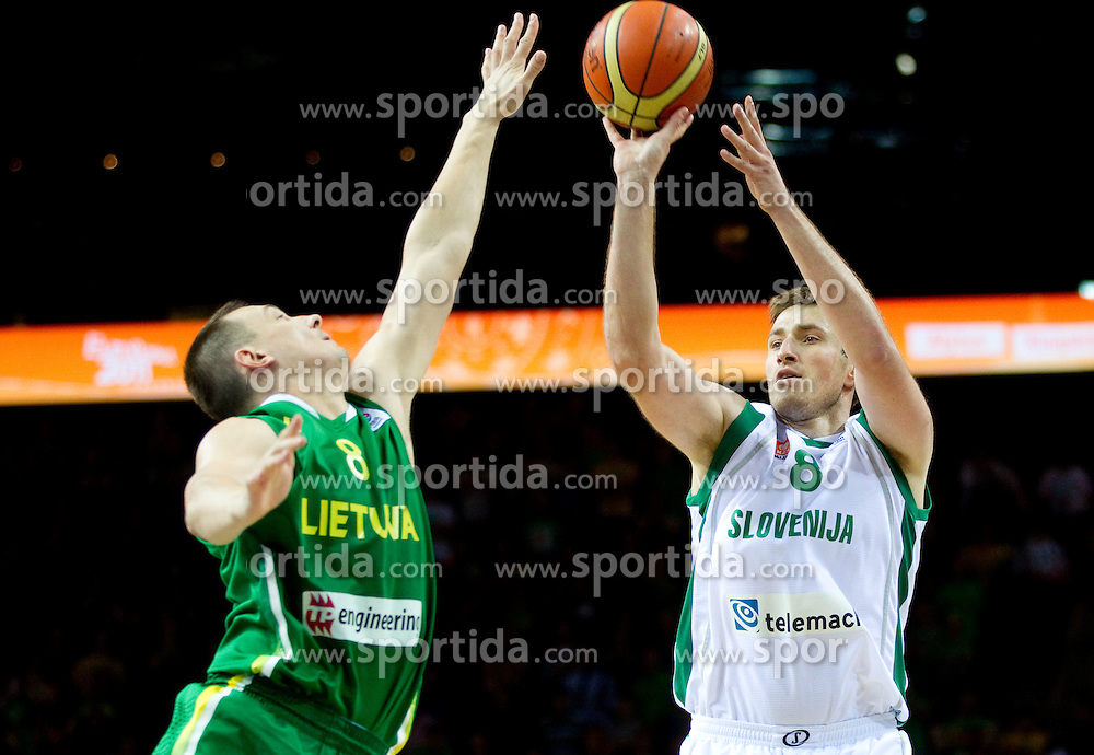 Paulius Jankunas of Lithuania vs Matjaz Smodis of Slovenia during basketball game between National basketball teams of Slovenia and Lithuania at of FIBA Europe Eurobasket Lithuania 2011, on September 15, 2011, in Arena Zalgirio, Kaunas, Lithuania. Lithuania defeated Slovenia 80-77.  (Photo by Vid Ponikvar / Sportida)