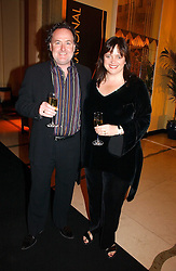 Finalist EMMA HARRISON founder of A4e Ltd and her husband JIM HARRISON at a reception for the winners of the 2006 Veuve Clicquot Award - Business Woman of the Year held at Claridge's Hotel, brook Street, London on 27th April 2006.  This years winner was Vivienne Cox, BP CEO for Gas, Power, Renewables and Integrated Supply & Trading.  The awards were presented by the Rt.Hon.Gordon Brown MP - The Chancellor of the Exchequer.<br />
