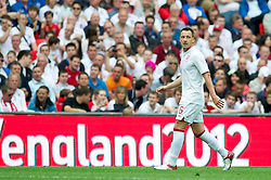LONDON, ENGLAND - Saturday, June 2, 2012: England's John Terry looks up as he is booed by the home fans as he is substituted against Belgium during the International Friendly match at Wembley. (Pic by David Rawcliffe/Propaganda)
