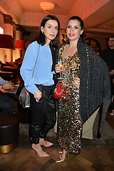Left to right, LARA BOHINC and GRACE WOODWARD at the unveiling of a Very Special Malone Souliers Christmas Tree, In Support Of Starlight Children's Foundation held at The Club Cafe Royal, Regent Street, London on 2nd December 2015.