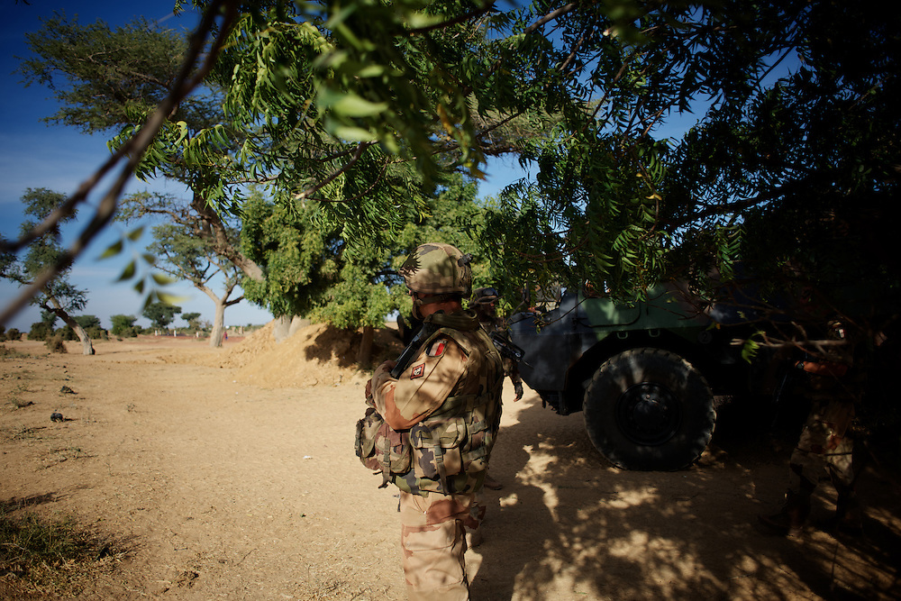 January 19, 2013 - Markala, Mali: French Army men take defensive position in the outskirts of Markala, in preparation for an advance towards the northern city of Diabaly, under siege by islamist militants since the 14th of January...Several insurgent groups have been fighting a campaign against the Malian government for independence or greater autonomy for northern Mali, an area known as Azawad. The National Movement for the Liberation of Azawad (MNLA), an organisation fighting to make Azawad an independent homeland for the Tuareg people, had taken control of the region by April 2012...The Malian government pledge to the French army to help the national troops to stop the rebellion advance towards the capital Bamako. The french troops started aerial attacks on rebel positions in the centre of the country and deployed several hundred special forces men to counter attack the advance on the ground. (Paulo Nunes dos Santos/Polaris)