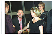 Lex Fenwick; Damien Hirst;  Kay Saatchi; Mrs. Lex Fenwick; Baby 2000  dinner, Truman Brewery. 4 November 1999.  *** Local Caption *** -DO NOT ARCHIVE-© Copyright Photograph by Dafydd Jones. 248 Clapham Rd. London SW9 0PZ. Tel 0207 820 0771. www.dafjones.com.<br /> Lex Fenwick; Damien Hirst;  Kay Saatchi; Mrs. Lex Fenwick; Baby 2000  dinner, Truman Brewery. 4 November 1999.
