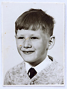 school memory portrait photo of young boy smiling 1960s
