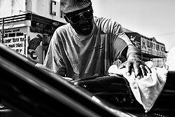 Dave Terrell, 57 works on polishing the exterior of a vehicle as members of the local classic and American muscle car community gathers for a meet on a North Philadelphia, on September 15, 2019.